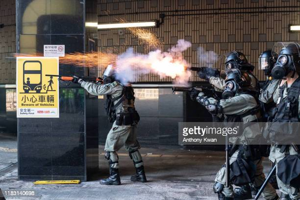 Riot police fire teargas and rubber bullets as protesters attempt to leave The Hong Kong Poytechnic University on November 18 2019 in Hong Kong China...