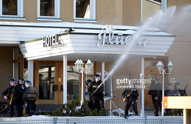 Riot police fire water canon at demonstrators in front of the Fluela hotel during a protest against the World Economic Forum annual Meeting on...