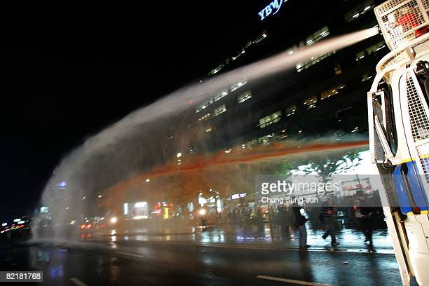 Riot police fire water canon to protesters during a rally against US President George W Bush's visit on August 5 in Seoul South Korea Bush is on an...
