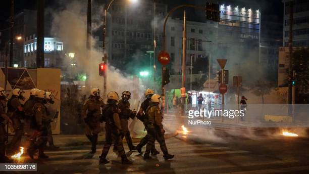 Riot police fired with tear gas as try to avoid petrol bombs by protesters
