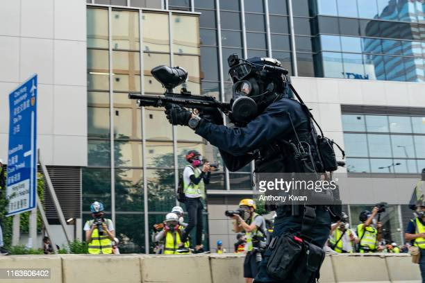 A riot police fires rubber bullet at protesters during an antigovernment rally in Kowloon Bay district on August 24 2019 in Hong Kong China...