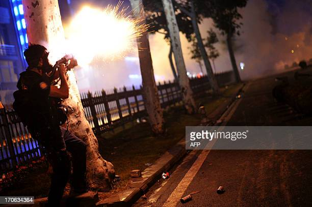 Riot police fires tear gas bomb to disperse protesters at Harbiye near Taksim square in Istanbul on June 16 2013 Police fired tear gas and jets of...