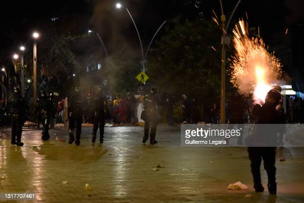 Riot police fires tear gas to disperse protesters in Bolivar square during national strike against Ivan Duque's administration on May 12, 2021 in...