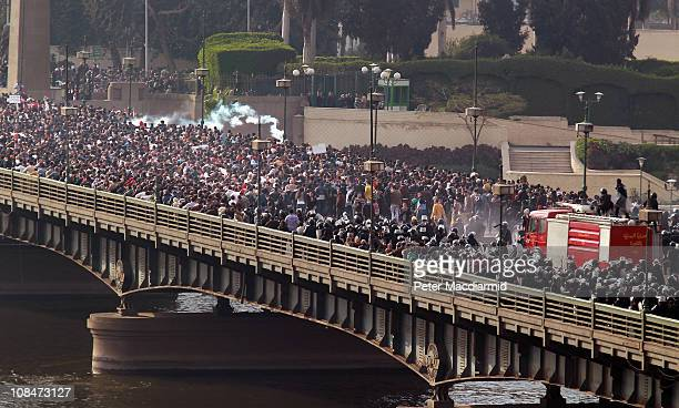Riot police force protestors back across the Kasr Al Nile Bridge as they attempt to get into Tahrir Square on January 28, 2011 in downtown Cairo,...