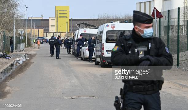Riot police forces are at work as part of an operation to shelter migrants on a voluntary basis in a bid to combat the spread of the Covid-19...