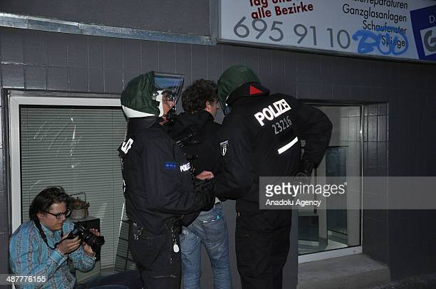 Riot police forces detain a protester in May Day rallies in the capital Berlin Germany on May 1 2014