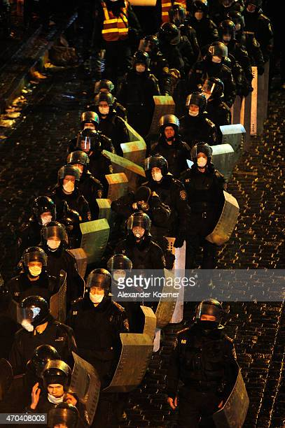 Riot police forces lineup at an entrance into Independence Square in Kiev on February 19 2014 in Kiev Ukraine At least 26 people have been killed and...