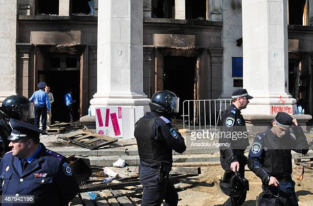 Riot police forces patrol in front of the Odessa's Trade Unions House in Ukraine's southern port city of Odessa on May 3 2014 At least 38 people have...