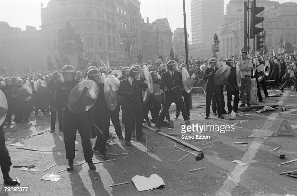 Riot police form a defensive line in Trafalgar Square during rioting which arose from a demonstration against the Poll Tax London 31st March 1990