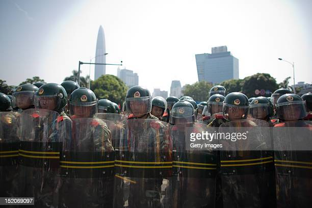 Riot police form a wall with their shields as anti-Japanese protesters demonstrate over the disputed Diaoyu Islands, on September 16, 2012 in...