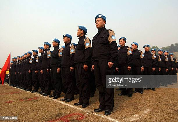 Riot police from Guangdong Province which will join the United Nations peacekeeping mission in Haiti gather at a training base for inspection...