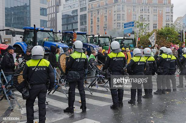 Riot police from Holland and Belgium working together during the farmers protest Farmers in clash with the riot police during a demonstration ahead...