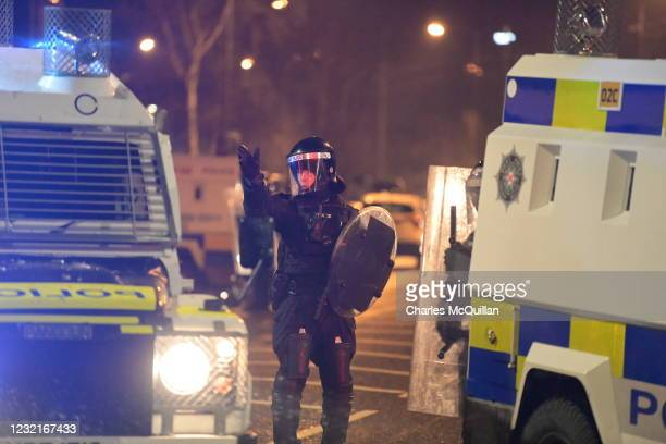 Riot police gather amid clashes between youths at the Springfield Road/Lanark Way interface on April 7, 2021 in Belfast, Northern Ireland. Violence...