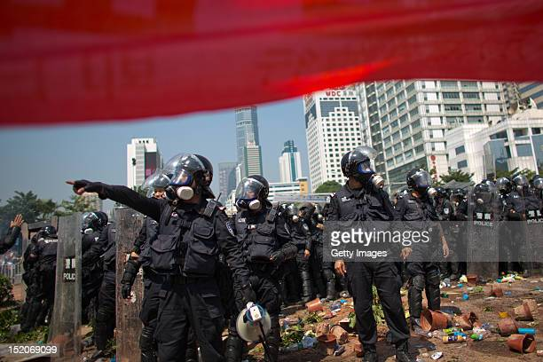 Riot police gather as anti-Japanese protesters demonstrate over the disputed Diaoyu Islands, on September 16, 2012 in Shenzhen, China. Protests have...