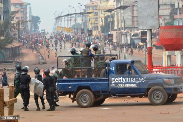 Riot police get ready to disperse people demonstrating to denounce the results of the local elections on February 6 2018 in Conakry Guinean...