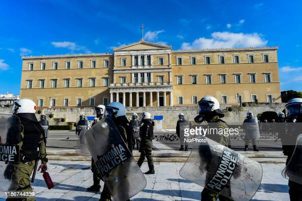Riot police guard in front of the Greek Parliament during a demonstration, in Athens, Greece on Friday, December. 6, 2019 commemorating the killing...