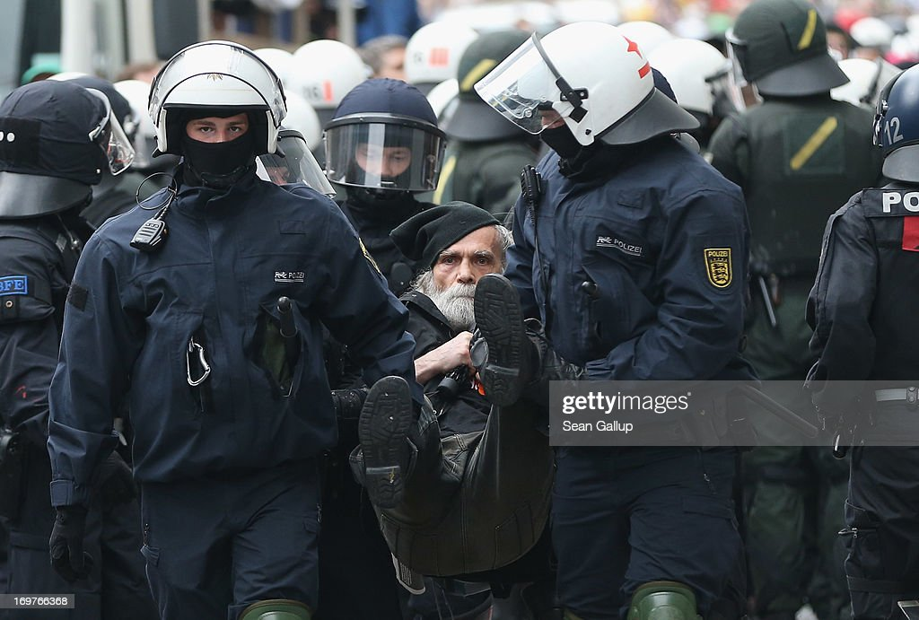 Riot police haul away a protester during the main Blockupy demonstration in the financial district on June 1, 2013 in Frankfurt am Main, Germany. Thousands of protesters are marching to demonstrate against capitalism, European Central Bank debt policy and the exploitation of textile workers in Third World countries, among other issues.