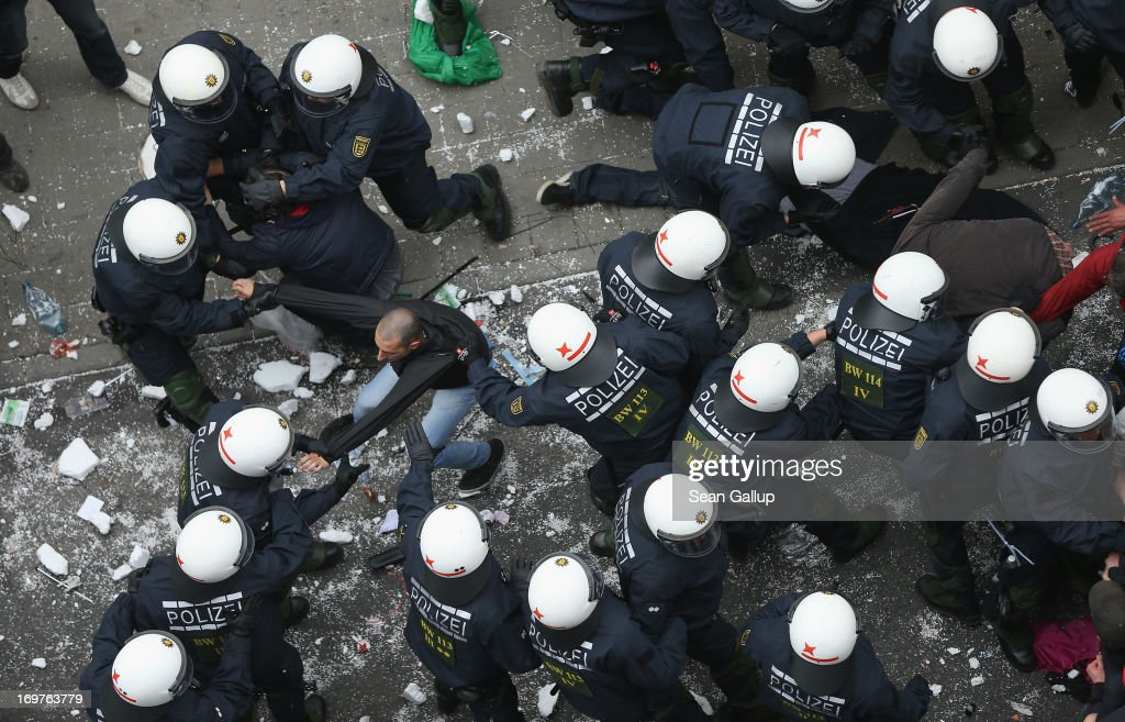 Riot police haul away protesters during the main Blockupy demonstration in the financial district on June 1, 2013 in Frankfurt am Main, Germany. Thousands of protesters are marching to demonstrate against capitalism, European Central Bank debt policy and the exploitation of textile workers in Third World countries, among other issues.
