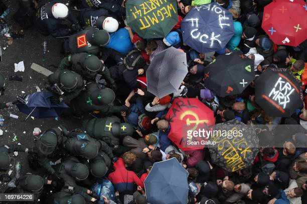 Riot police haul away protesters during the main Blockupy demonstration in the financial district on June 1 2013 in Frankfurt am Main Germany...