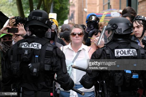 Riot police hold back antifascist counterprotesters in Portland Ore United States on August 17 after Proud Boys descended on the city