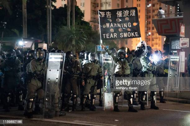 Riot police hold up a warning flag during a demonstration in Wong Tai Sin District on August 5 2019 in Hong Kong China Prodemocracy protesters have...