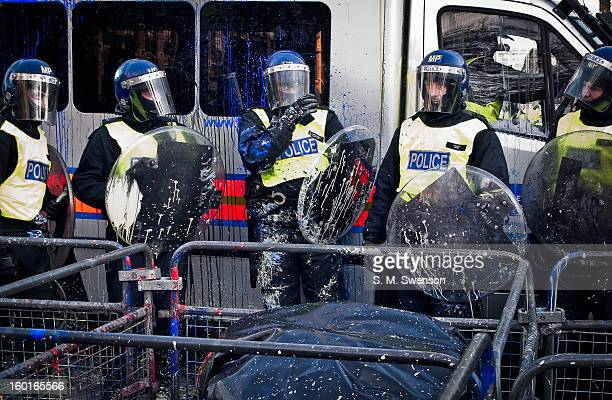 CONTENT] Riot Police in full gear and shields were paintballed by demonstators at the student demonstration on December 9 2010 Parliament was voting...