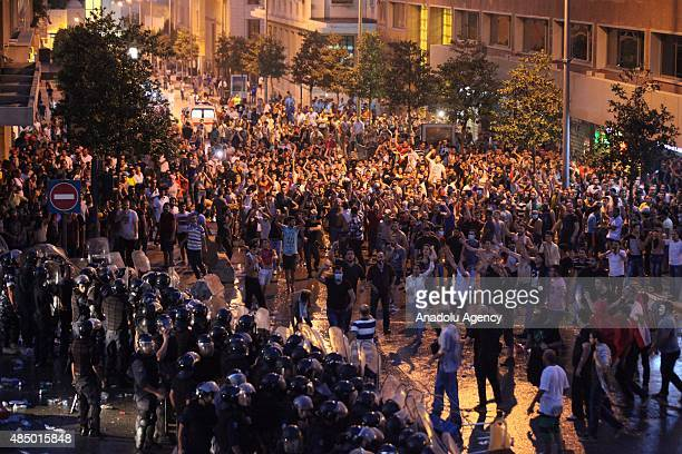 Riot police in Lebanon clash with crowds in front the government house during a demonstration against the ongoing garbage crisis on August 23 2015 in...