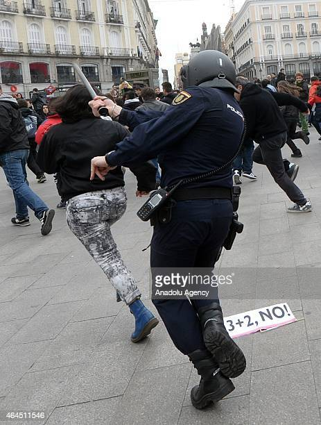 Riot police interfere to the protesters during the demonstration held to protest the new laws enacted to make education reforms in Madrid Spain on...