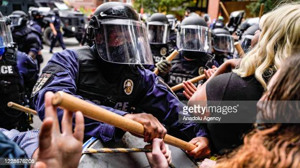Riot police intervene in protesters in Louisville, Kentucky, on September 23 after a judge announced the charges brought by a grand jury against...