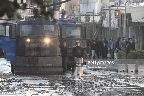 Riot police intervenes in an antigovernment protest in Sulaymaniyah Iraq on December 18 2017 Protests continue as demonstrators keep on setting party...