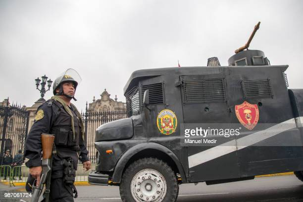 Riot police is seen during a protest against corruption in public institutions in front of Government Palace on June 27 2018 in Lima Peru