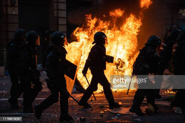 Riot police is seen during the clashes with catalan protesters during a general strike called following a week of protests over the jail sentences...