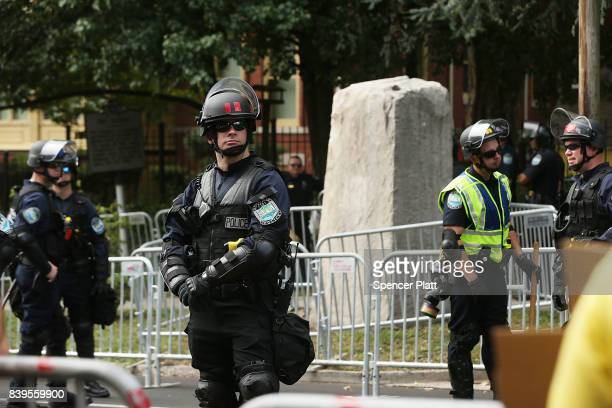 Riot police keep guard beside a Confederate monument in Fort Sanders in advance of a planned white supremacist rally and counterprotest around the...