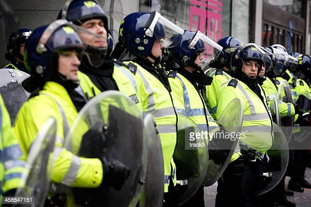 Riot police line, London.