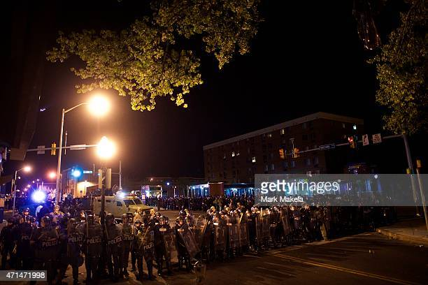 Riot police line the street after curfew and dispensing tear gas the night following citywide riots over the death of Freddie Gray on April 28, 2015...