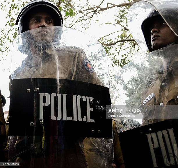 Riot police lined the streets opposite the Hilton hotel in Colombo to prevent protesters from marching to the President's residence. In what is...