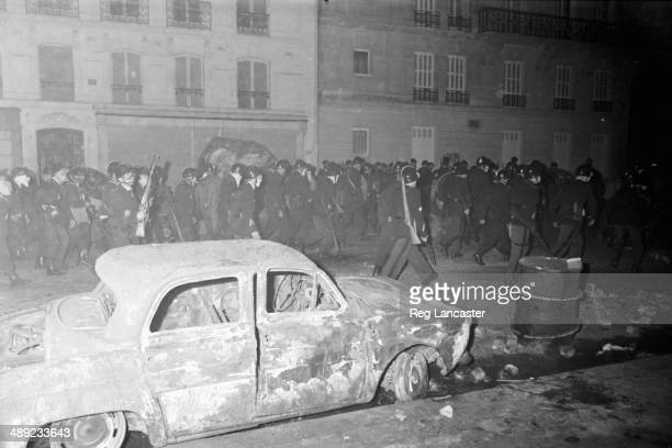 Riot police lining the rubble strewn streets of the Paris Latin Quarter during the riots France 25th May 1968