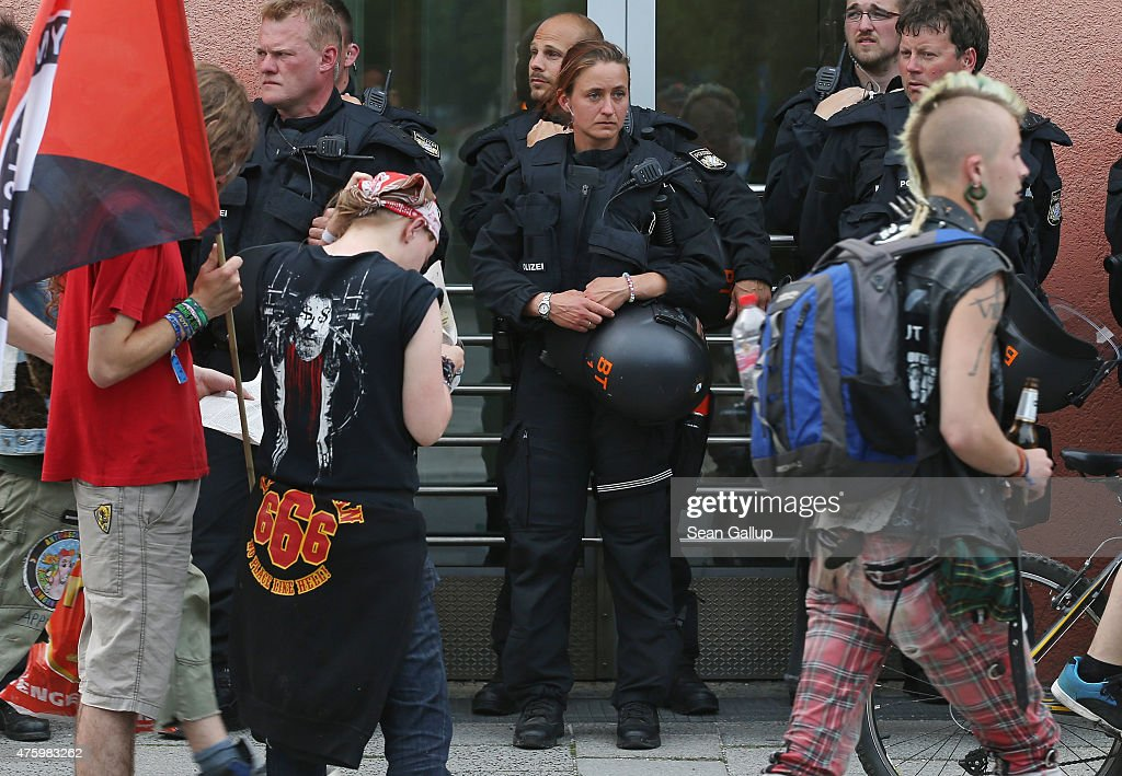 Riot police look on as activists who have come to protest linger at the main railway station two days before the summit of G7 leaders on June 5, 2015 in Garmisch-Partenkirchen, Germany. G7 leaders will meet at nearby Schloss Elmau on June 7-8 and protesters will hold a variety of gatherings and demonstrations in coming days to voice their opposition.