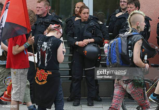 Riot police look on as activists who have come to protest linger at the main railway station two days before the summit of G7 leaders on June 5 2015...