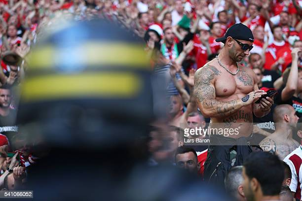 Riot Police look on at supporters during the UEFA EURO 2016 Group F match between Iceland and Hungary at Stade Velodrome on June 18 2016 in Marseille...