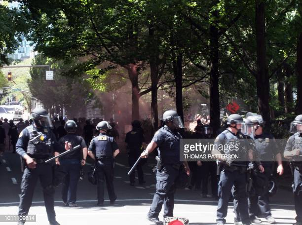Riot police maintain vigil as altright activists antifascist protestors and people on all sides of the political spectrum gather for a campaign rally...