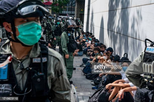 Riot police mass detain pro-democracy protesters during a rally in Causeway Bay district on May 27, 2020 in Hong Kong, China. Chinese Premier Li...