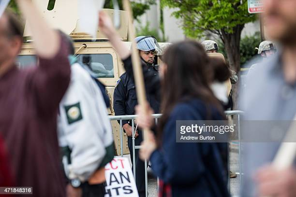 Riot police monitor protesters during a march May 1, 2015 in Baltimore, Maryland. Maryland state attorney Marilyn J Mosby announced that charges...