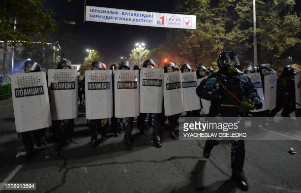 Riot police move to disperse protesters during a rally against the results of a parliamentary vote in Bishkek on October 5, 2020.