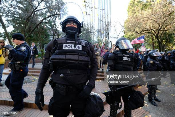 Riot police movies to separate antifascist protesters and Patriot Prayer supporters ahead of a march for Kate Steinle in Portland, United States on...