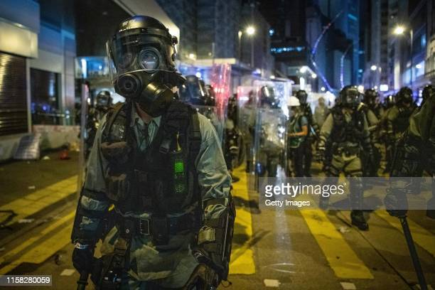 Riot police officer advances during a demonstration in the area of Sheung Wan on July 28, 2019 in Hong Kong, China. Pro-democracy protesters have...