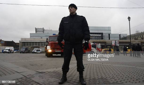 A riot police officer guards the area next to the entrance to Sennaya Square metro station in Saint Petersburg on April 3 2017 Russia's Investigative...