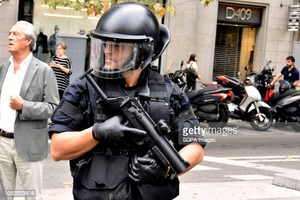 Riot police officer seen on guard during the protest Antifascists protest against the Spanishism in Barcelona during the celebration of the Hispanic...