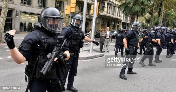 Riot police officers are seen on guard during an antifascist protest against 'Spanishism' in Barcelona during the celebration of the Hispanic Day