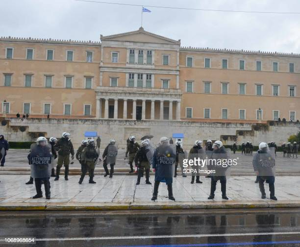 Riot Police officers are seen on guard during the protest Protest to mark the 10th Anniversary of Alexis Grigoropoulos he was shot fatally by a...
